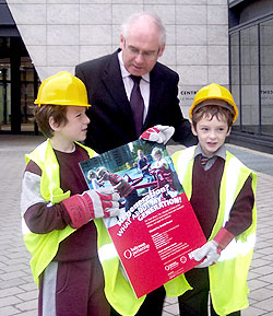 2 local children Declan and Robert Fitzpatrick and Minister Noel Ahern.